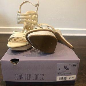 Cream strapped heels